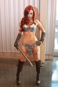 Red-haired beauty with the powerful sword in hand – Sexy Bitches Gifs