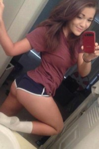 Sexy Coed In Short Shorts Takes A Selfie With Her Phone