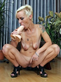 Skinny little blonde with pendulous breasts masturbates her old cunt