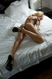 amazing handsome blonde laying hot with her great ass and great legs in provocative lingerie