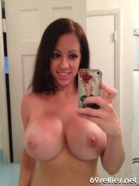 69 SELFIES !!! – MASSIVE BOOBS smiling brunette
