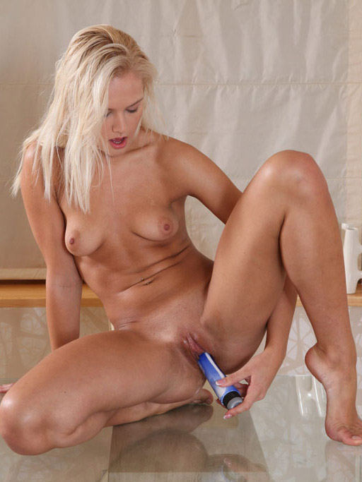 Sexy young blonde plays with toys – DaChicky