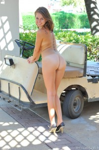 Tanned beauty poses at the open air – DaChicky