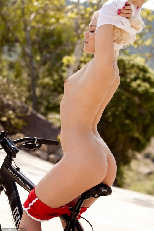 Teen girl enjoys to ride a bike – DaChicky