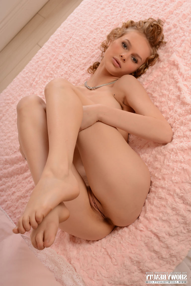 Curly-haired babe Nika poses on the bed – DaChicky