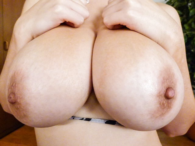 Airu Oshima rubs and shows off her big natural boobs on javHD.com