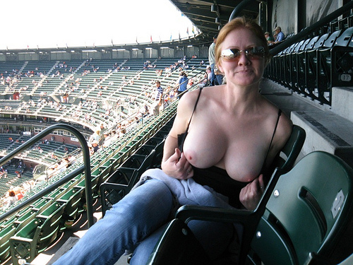 Milf flashing big tits on stadium – Public Flashing