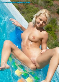 Cute Smile Blonde At Pool
