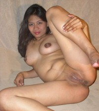 Asian bitch with shaved pussy