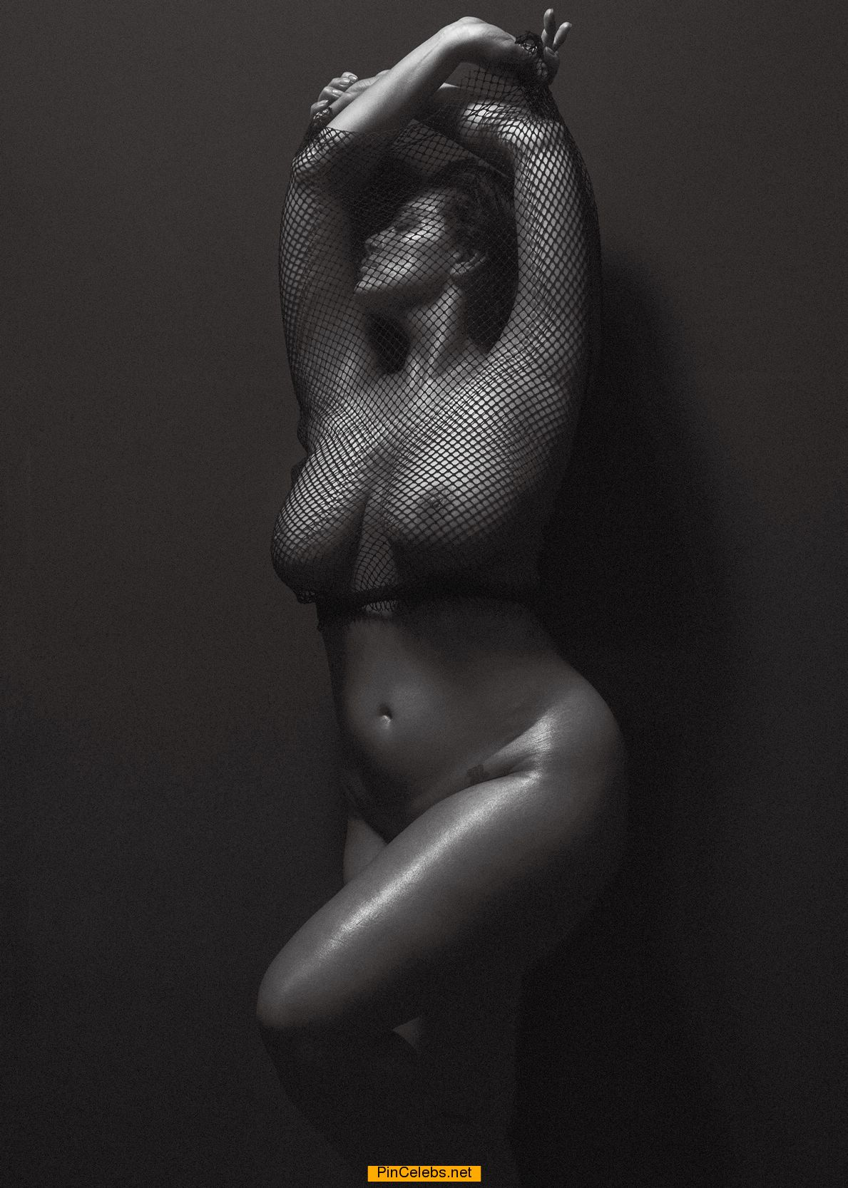 Ashley Graham posing nude