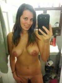 Busty MILF takes naked selfie in the bathroom