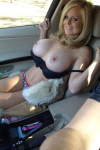 Milf woman is proud of big breasts