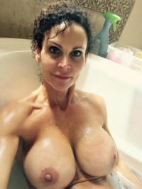 Big tits Mom takes a bath