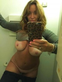 Fantastic MILF without bra on nude selfie