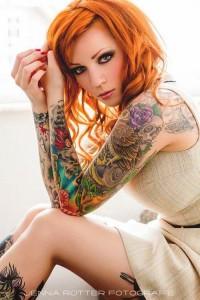 beautiful redhead girl with tattoos