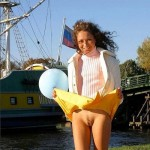 She likes to flirt by flashing her yellow skirt – Sexy Bitches Gifs