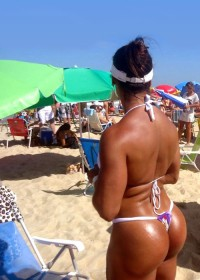 girl with sun big tight butt in bikini