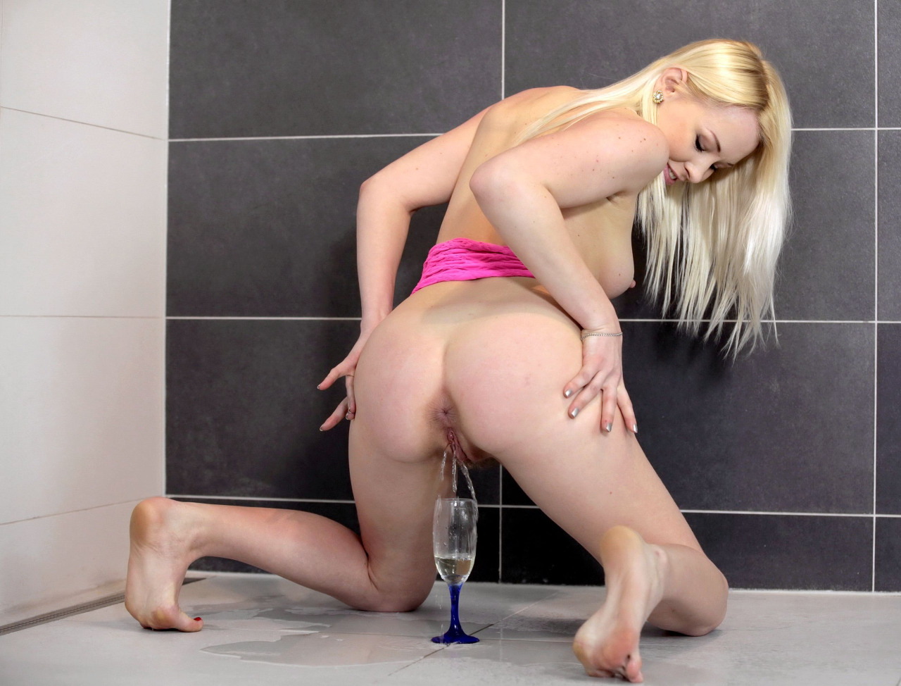Sexy blonde Lola Taylor peeing into wineglass