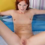 Sensual redhead chick shows her snatch – DaChicky