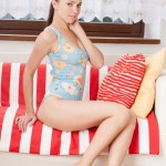 Young brunette poses on the sofa – DaChicky