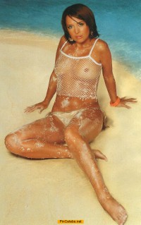 Russian singer Jeanna Friske in see through top on a beach
