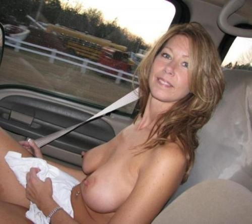 Busty Milf in car flashes tits