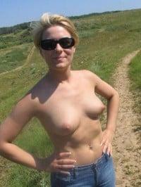 Russian blonde wife topless walking