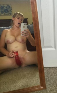Blonde MILF fucks her pussy with dildo on selfie