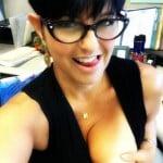 Brunette in glasses looks unkindly