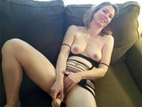 Smiling mother playing with dildo