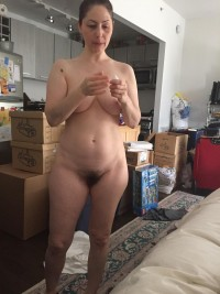 Beautiful Milf girl gets naked in the guest room to stuff her hairy pussy