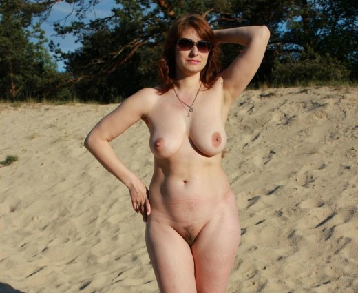 Beautiful mom completely naked on the beach