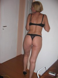 MILF hottie strikes sexy poses home in ripped bodystocking