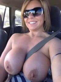Smiling mature mom shows her hard nipples