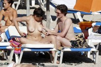 Daisy Lowe changing on the beach shows her nude boos