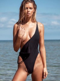 Danielle Knudson in bikini and topless but covered | Celebs Dump