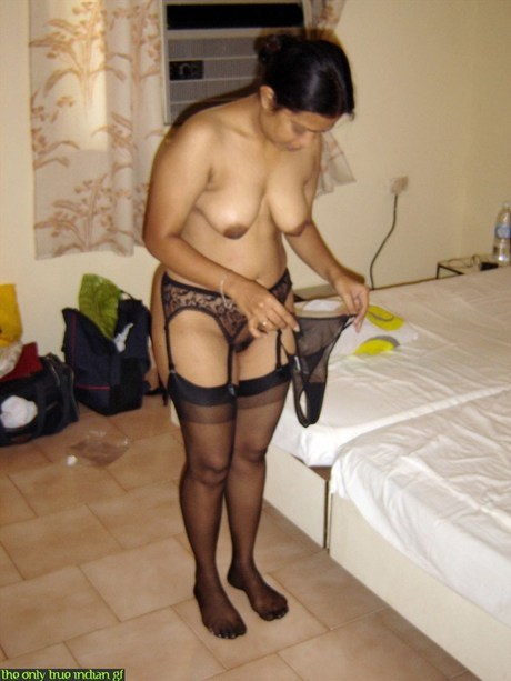 Naked Indian wife pulls on black nylons and garters on edge of bed – Nude Sex Pics